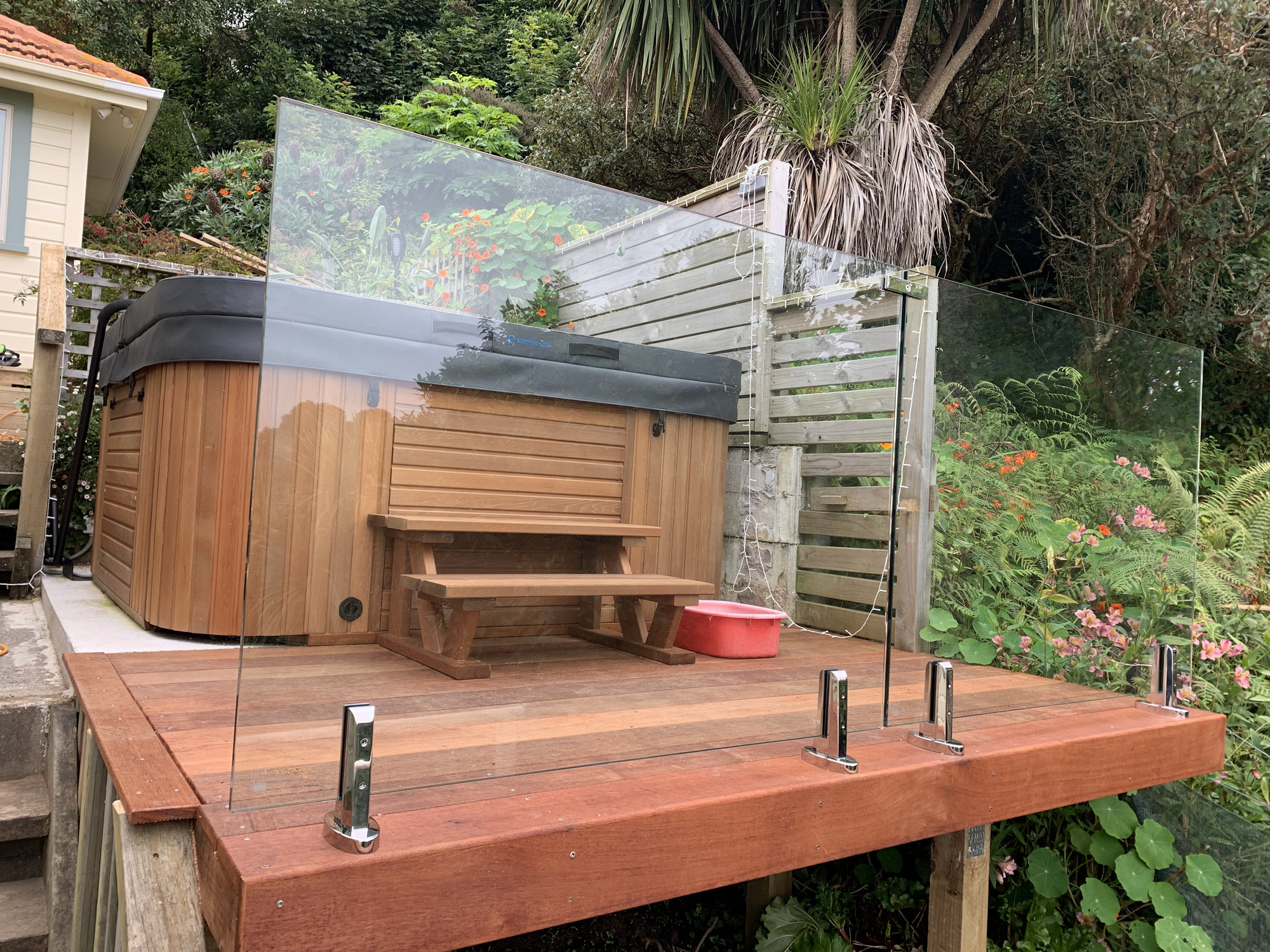 Spa area with decking and glass safety screen