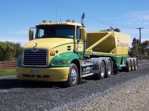 Mack #11 towing Southern Transport Bottom Dumper