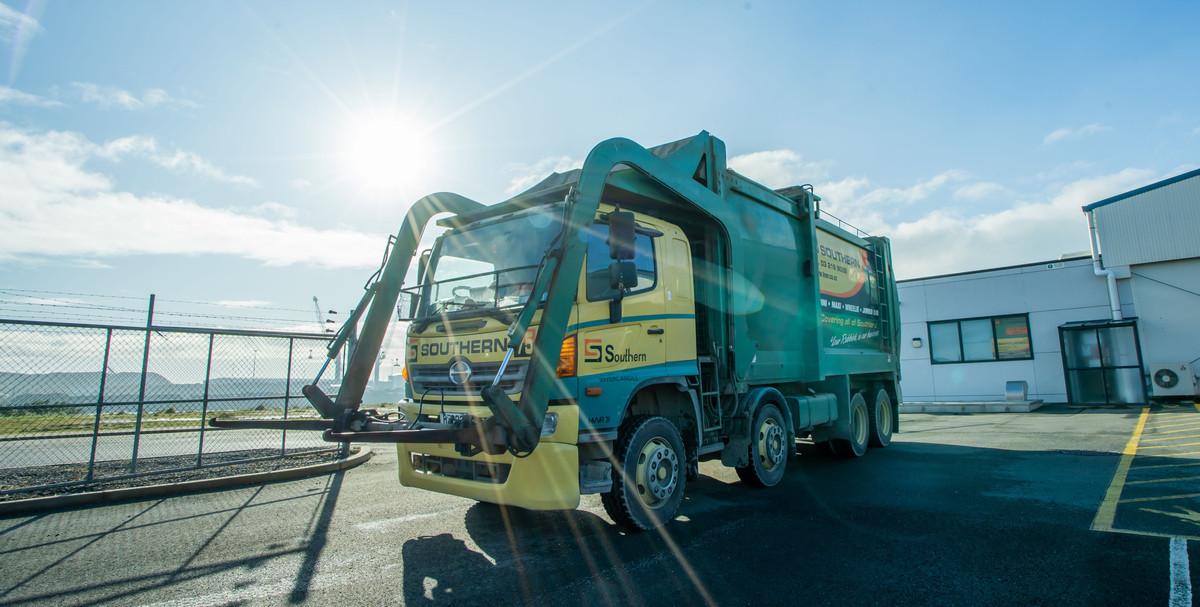 Southern Transport skip truck Front loader #75 down at Bluff Port  emptying skip bins