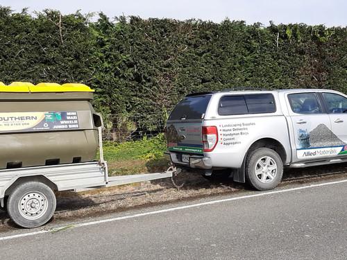 Allied Materials Ute delivering Plastic skip bin