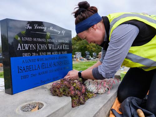Working around plants to add a headstone addition