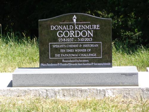 Saddle top headstone on grey granite base
