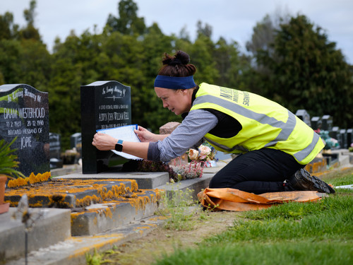 Jenna lining up a gravestone for an addition