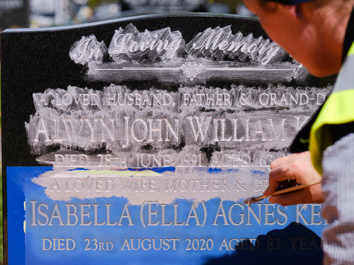 The pigment on this headstone is getting its final coat