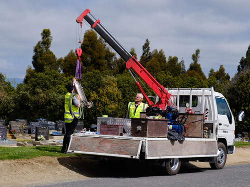 Using the crane at the cemetery