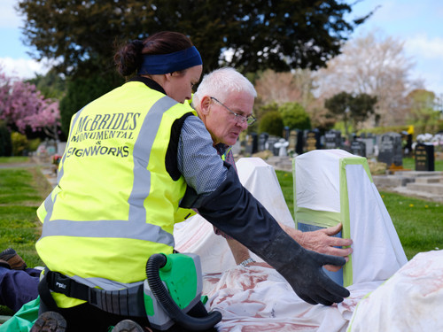 Doug, a New Zealand Master Monumental Masons Association (NZMMMA) member, training Jenna