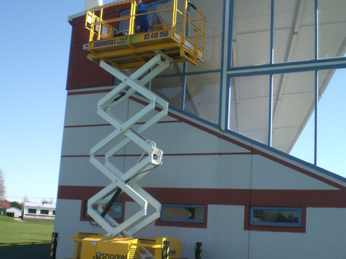 Easily clean spouting with the scissor lift hire from Signworks Balclutha