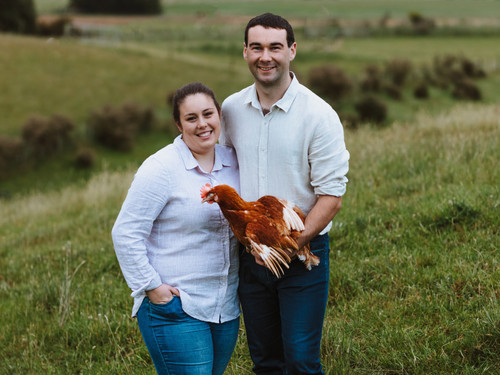 TIm and Jess with one of their chickens